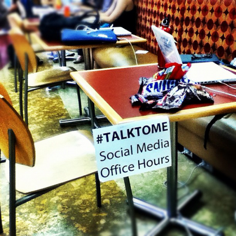 Followup photo of my table (note the candy!) and the sign when I got to Mudd in the afternoon.