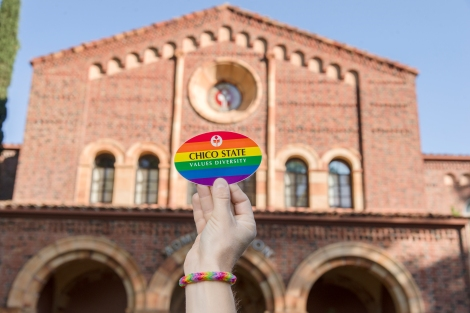 A photo illustration for Chico State that shows the university's support for marriage equality and diversity with a rainbow sticker held up outside Kendall Hall on Thursday, June 25, 2015 in Chico, Calif. Recently, The Supreme Court ruled that states cannot keep same-sex couples from marrying and must recognize their unions. The decision was 5-4. (Jason Halley/University Photographer)