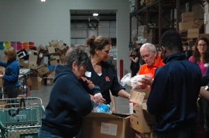 Carroll University alumni and friends sorted over 7000 lbs of food at Feeding America Eastern Wisconsin's food bank this year.