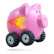 Economic acceleration. Piggy bank on wheels.